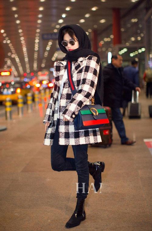 ionysus古琦包包 冬季机场街拍凹造型图片